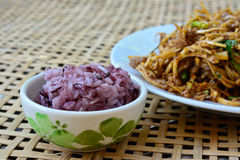 Spicy banana bud with pork salad  and black sticky rice on bambo Royalty Free Stock Image