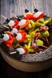 Spicy banderillas for spanish corrida. Closeup of spicy banderillas for spanish corrida Stock Photography