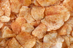 Spicy barbecue flavored potato chips Royalty Free Stock Images