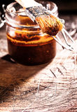 Spicy basting sauce and brush Royalty Free Stock Photography