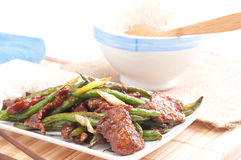 Spicy beef with green beans and white rice. Spicy beef and green beans with rice, thai inspired dinner Royalty Free Stock Images