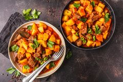 Spicy beef stewed with potatoes in tomato sauce, top view. Meat stock images