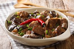 Spicy beef with wild mushrooms, chili pepper and gravy closeup i Stock Photography