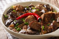 Spicy beef with wild mushrooms and gravy closeup. horizontal Royalty Free Stock Images