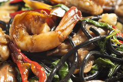 Spicy black spaghetti with prawns Stock Images