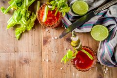 Spicy bloody mary cocktail with garnish stock photography
