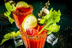 Spicy bloody mary cocktail with garnish stock images