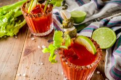Spicy bloody mary cocktail with garnish stock photos