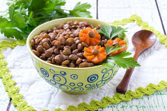Spicy boiled lentils with carrots and herbs Stock Image