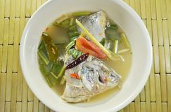 Spicy boiled mango fish head in Tom Yum soup on bowl. Spicy boiled mango fish head in Tom Yum soup on the bowl Royalty Free Stock Images