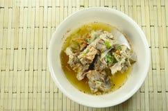 Spicy boiled pork bone dressing cayenne pepper soup on bowl. Spicy boiled pork bone dressing cayenne pepper soup on the bowl Stock Photo