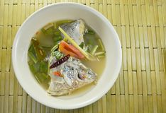 Spicy boiled Tilapia fish head in Tom Yum soup on bowl. Spicy boiled Tilapia fish head in Tom Yum soup on the bowl Royalty Free Stock Images