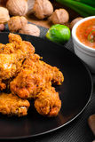 Spicy breaded chicken wings with homemade bread Royalty Free Stock Photography
