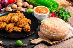 Spicy breaded chicken wings with homemade bread. All homemade stock photo