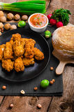 Spicy breaded chicken wings with homemade bread Royalty Free Stock Photo