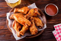 Spicy Buffalo Chicken Wings. A serving of delicious spicy buffalo chicken wings on a restaurant table top stock images