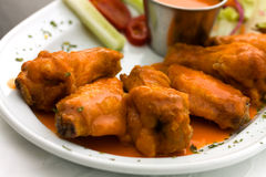 Spicy Buffalo Wings with Blue Cheese Dip Celery an Royalty Free Stock Photography