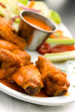 Spicy Buffalo Wings with Blue Cheese Dip Celery an Royalty Free Stock Photos