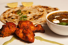 A spicy butter Paneer Masala with roti and kebab Stock Images