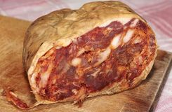 Spicy calabrese salami. Salame brawn, typical product spicy Calabrian natural of pork meat with spicy chili and natural flavors Royalty Free Stock Photography