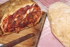 Spicy calabrese salami. Salame brawn, typical product spicy Calabrian natural of pork meat with spicy chili and natural flavors Royalty Free Stock Photos