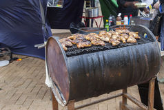 Spicy Caribbean Barbequed Chicken. Street food. Spicy Caribbean Barbequed Chicken on oil drum Stock Image