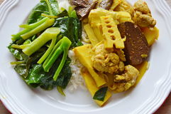 Spicy chicken with bamboo shoot curry and stir fried Chinese kale on rice Royalty Free Stock Photo