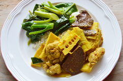 Spicy chicken with bamboo shoot curry and stir fried Chinese kale on rice Stock Images