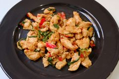 Spicy Chicken with basil and asian ingredient in Thai style. Street food Royalty Free Stock Photos