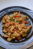 Spicy Chicken with basil and asian ingredient in Thai style. Street food Stock Image