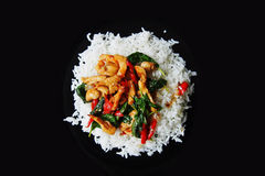 Spicy chicken basil with rice. Top view Stock Images
