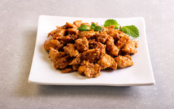 Spicy chicken breast with sesame on plate stock images