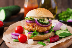 Spicy chicken burgers with tomato and eggplant - sandwich. Royalty Free Stock Photos