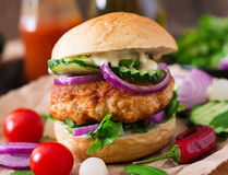 Spicy chicken burgers with tomato and eggplant - sandwich. Royalty Free Stock Images