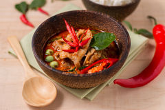 Spicy chicken curry in wooden cup and wooden table ,popular Thai Royalty Free Stock Image