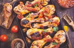 Spicy chicken drumsticks on serving pan closeup Royalty Free Stock Image