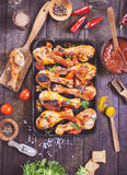 Spicy chicken drumsticks on serving pan Royalty Free Stock Image