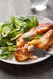 Spicy Chicken Enchiladas with fork and water Stock Images