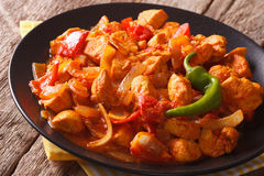 Spicy chicken jalfrezi with pepper and onion close-up. horizonta Stock Images