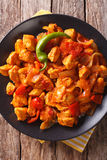 Spicy chicken jalfrezi with pepper and onion close-up. Vertical Stock Photo
