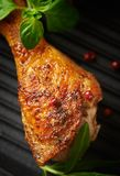 Spicy Chicken Leg with Herbs. Roasted chicken drumstick, crispy golden brown skin. stock images