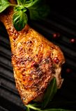 Spicy Chicken Leg with Herbs. Roasted chicken drumstick, crispy golden brown skin. Top view stock photos