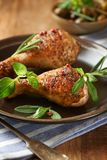 Spicy Chicken Legs with Herbs. Roasted chicken drumsticks, crispy golden brown skin. stock images