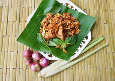 Spicy chicken ligament salad on banana leaf. Spicy chicken ligament salad on fresh banana leaf royalty free stock photos