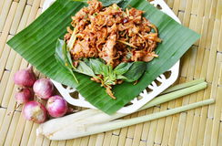 Spicy chicken ligament salad on banana leaf. Spicy chicken ligament salad on fresh banana leaf stock photo