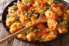 Spicy chicken in orange sauce closeup. horizontal. Spicy chicken in orange sauce closeup on a plate. Horizontal Royalty Free Stock Images