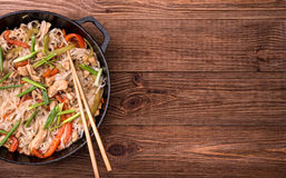 Spicy chicken and veggie noodles. Stock Image