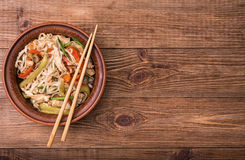 Spicy chicken and veggie noodles. Stock Photo