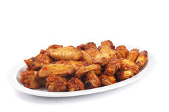 Spicy chicken wings. Spicy buffalo wings in a plate royalty free stock images