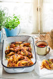 Spicy chicken wings in summer kitchen Royalty Free Stock Photography